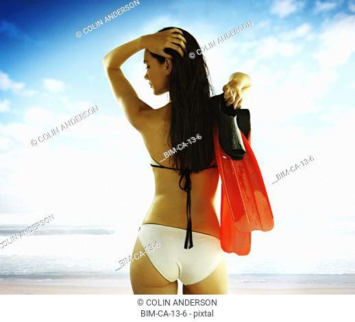 Young woman wearing a bikini on the beach