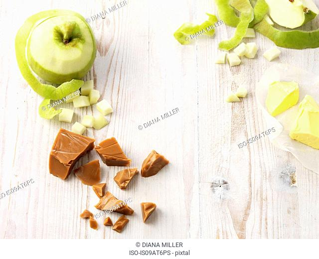 Ingredients for toffee apple pudding on whitewashed wooden table