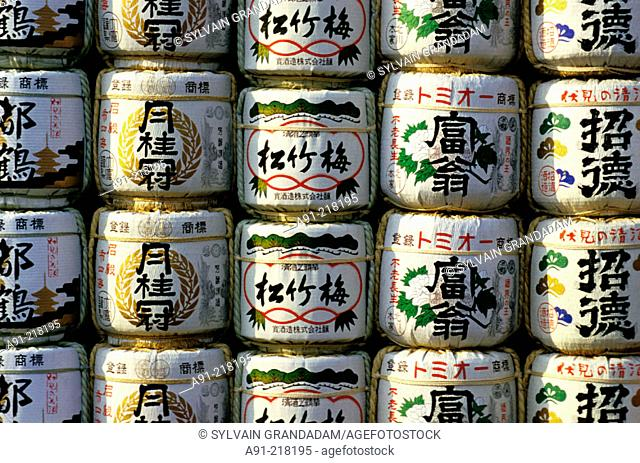Sake bottles (offerings) at entrance to shrine. Tokyo. Japan