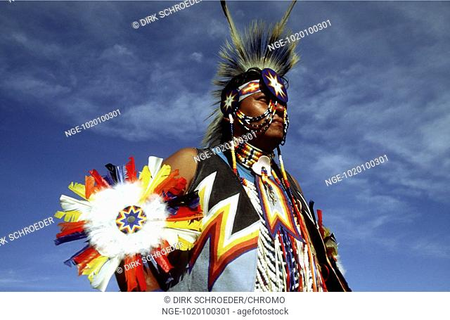 Lakota Man with glorious Clothing and Feathered Headdress, Chickendancer