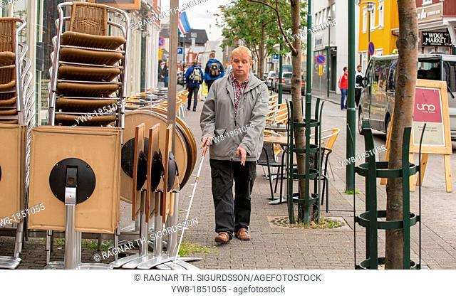 Blind man using a cane, Reykjavik, Iceland
