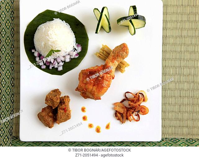 Burmese meal, curries, rice, side dishes,