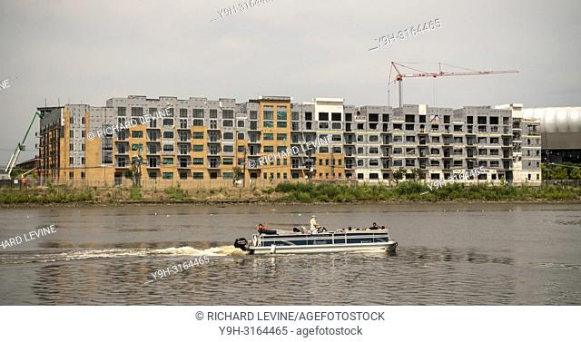 Construction of apartment buildings, in close proximity to the PATH commuter line, along the Passaic River in Harrison, NJ on Saturday, August 25, 2018