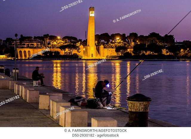 BRINDISI, ITALY Quayside. Harbor. Old town. The Italian sailor monument
