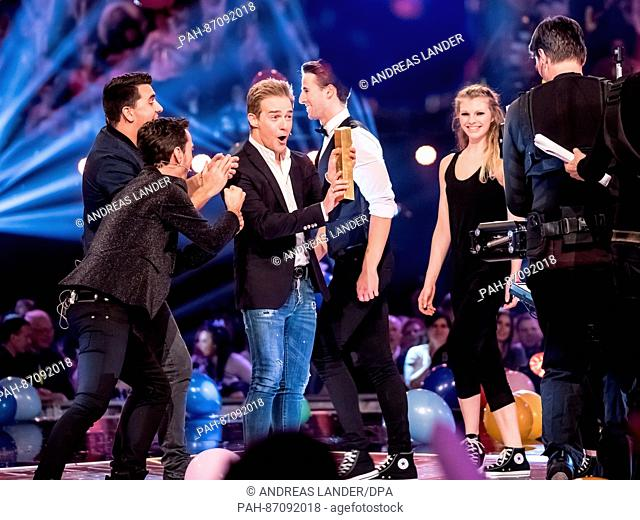 """The Band """"""""Klubbb3"""""""" with the musicians Florian Silbereisen, Jan Smit and Christoff de Bolle (with the award """"""""The number one of the Best"""""""") during the TV Show..."""