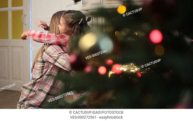 Mother and daughter hugging at Christmas at home