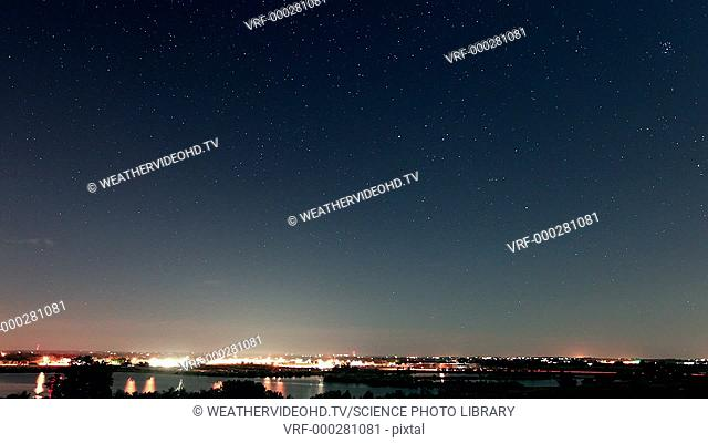 Perseids meteor shower. Time-lapse footage of the night sky in August with several streaks of light created as meteors impact the atmosphere