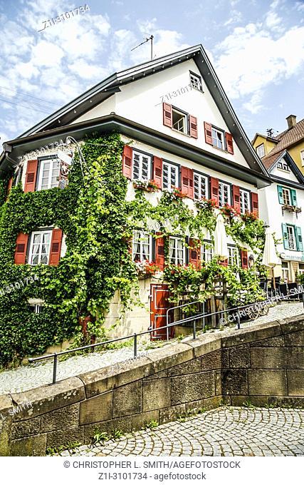 Ivy covered hotel and restaurant Schlossberg on Bewertungen Strasse in Nurtingen, Southern Germany