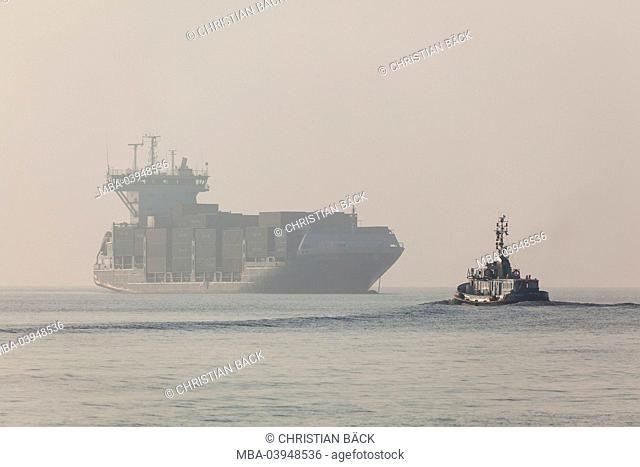 Container ship on the North Sea in front of Brunsbuttel, Ditmarsh, Schleswig - Holstein, North Germany, Germany