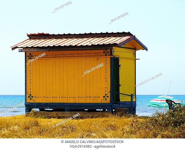 Yellow painted shacks housing in San Agostino Beach, Civitavecchia, Rome Province, Lazio, Italy