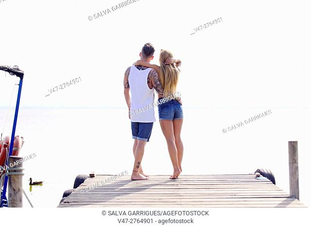Bridal couple hugging on the pier at Lake Albufera of Valencia, Spain, Europe