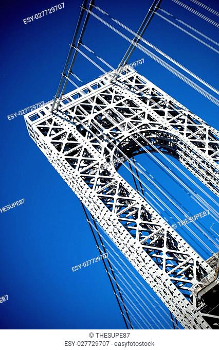 A close up portion of the large gate and metal detail on the New York City George Washington Bridge as seen from below