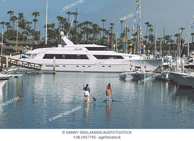 Two women paddle boarding in San Diego Bay