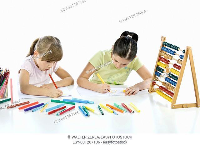 Portrait of smiling schoolchildren draws a picture