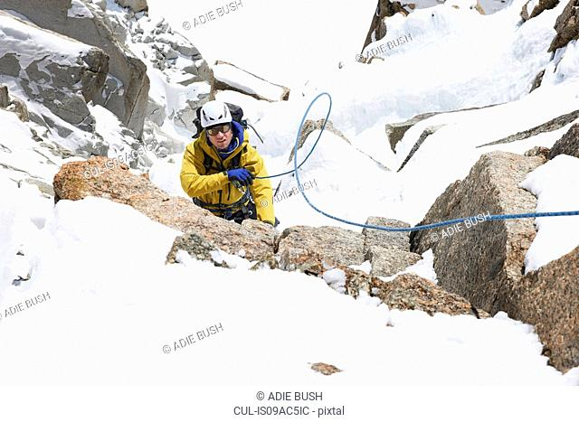 Mid adult man with climbing rope