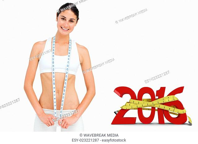 Composite image of slim woman with a measure tape