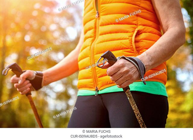 Cropped shot of senior female nordic walker exercising in park