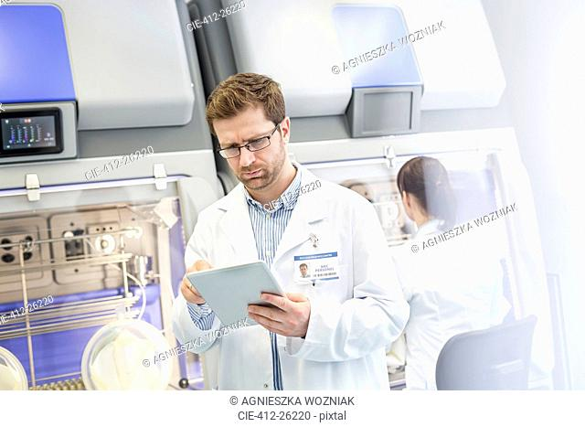 Scientist using digital tablet in laboratory