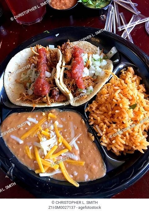Two soft-shell Tortilla's with rice and refried beans