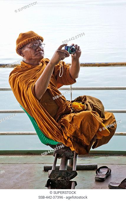 Thailand,Trat Province,Koh Chang,Koh Chang Ferry,Monk Taking Photo