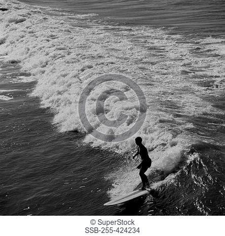 USA, California, Surfer at Pismo Beach