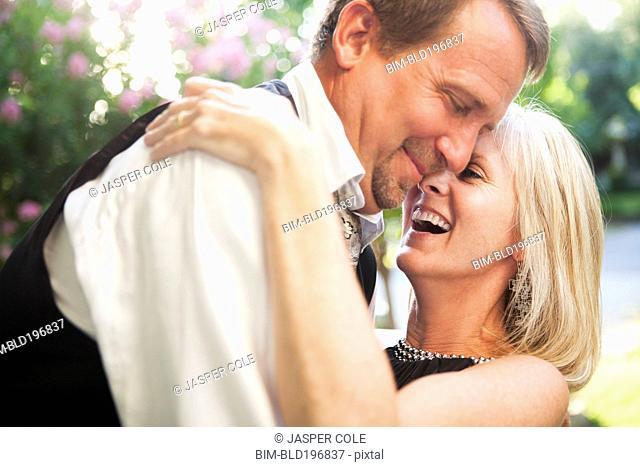 Elegant Caucasian couple hugging