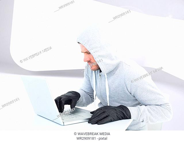 Criminal Man in hood on laptop in front of modern background
