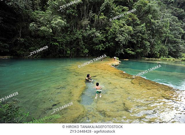 Semuc Champey, in the Alta Verapaz region of Guatemala, consists of a natural limestone bridge and natural pool