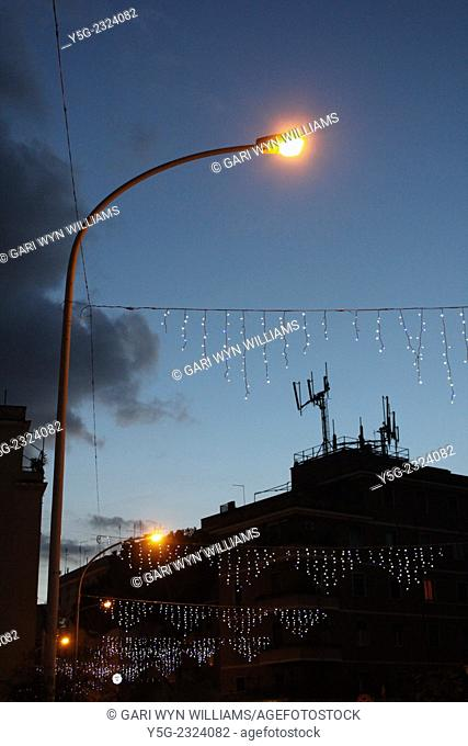 Rome Italy. 17th December 2014 Christmas lights and decorations on the busy Via Jenner shopping street in the Monteverde district of Rome Italy
