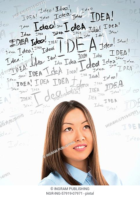 Idea concept. Young business woman with idea signs in front