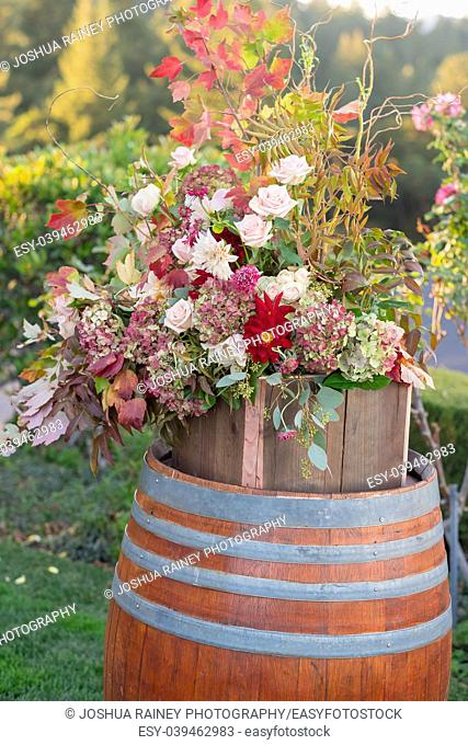 Wedding ceremony with flowers on wine barrels for decor at this beautiful California winery celebration