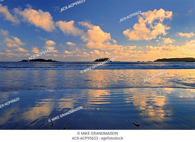 Clouds reflecting in Pacific Ocean at Long Beach at sunrise Pacific Rim National Park British Columbia Canada