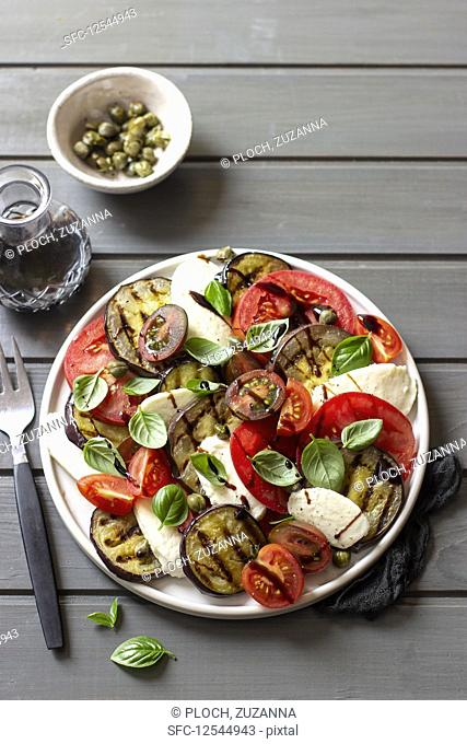 Caprese salad with grilled aubergine slices and capers