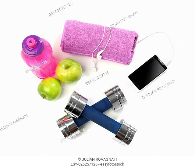 Fitness concept with a bottle of water, a towel, dumbbells, apples and a smartphone isolated