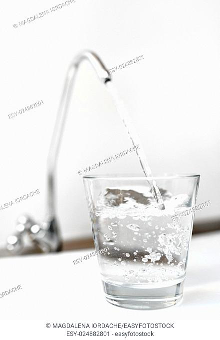 A glass of water from filter tap