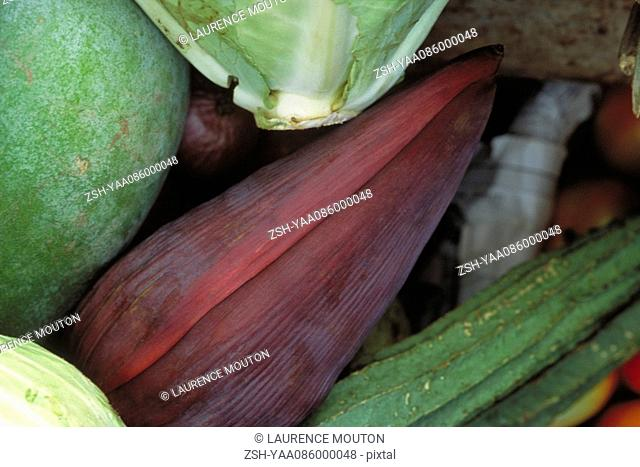 Banana flower and assorted vegetables, close-up