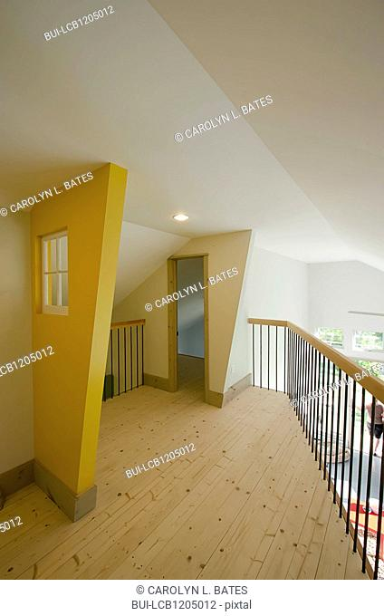 Empty wooden hall with doorway and railing at home; USA