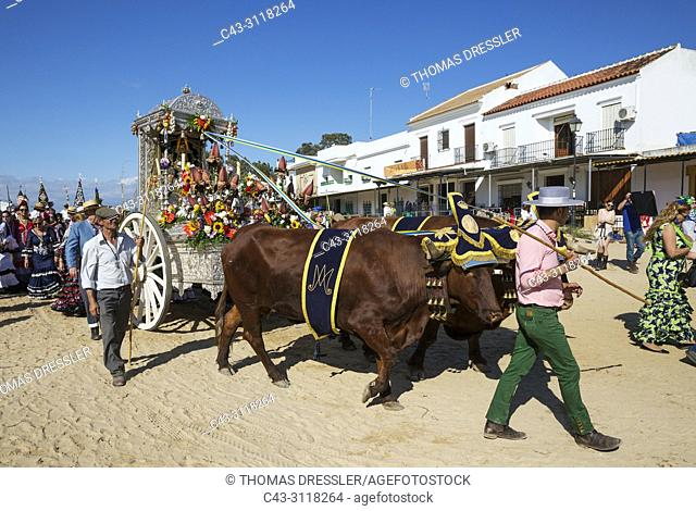 During a famous Pentecost pilgrimage the village of El Rocio converts into a colourful spectacle with lavishly decorated ox-carts