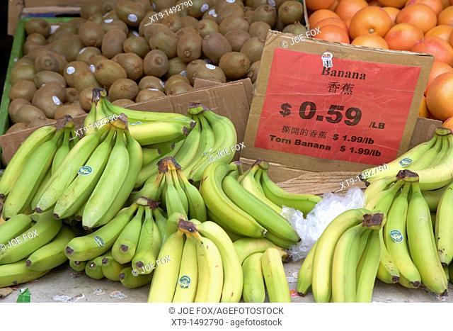 bananas kiwifruit and oranges on a chinese market stall in toronto ontario canada