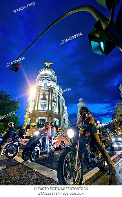 Traffic by the Metropolis building and Gran Via street at twilight. Madrid, Spain