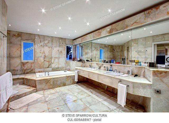 Marble tiled bathroom of luxury villa