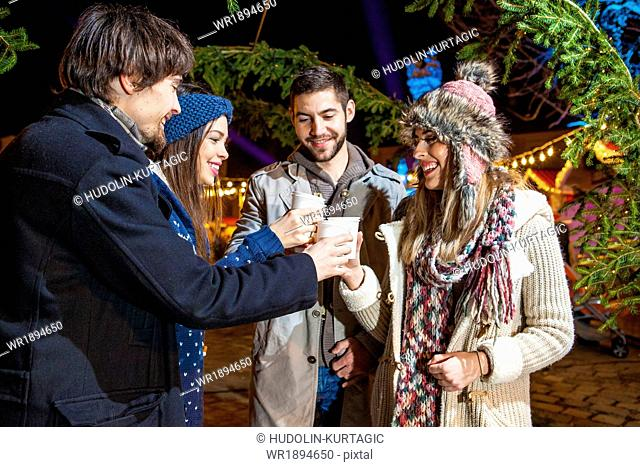 Friends drinking punch at Christmas Market