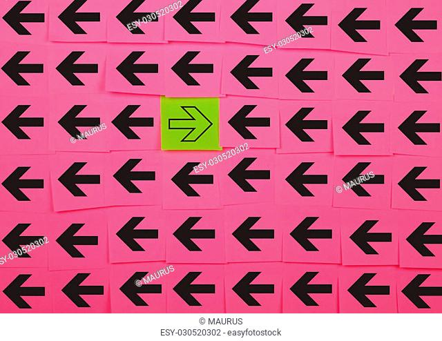 Arrows. Opposite concept. Background of pink sticky notes