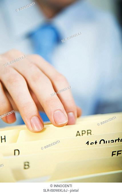 Office worker filing document