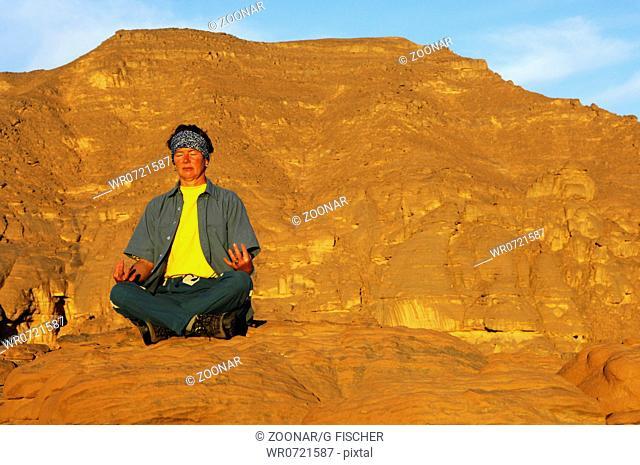 Young woman practisizing yoga
