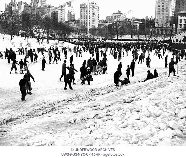 New York, New York: c. 1928 Thousands gather at Central Park's 59th Street Lake for the annual Winter Sports Carnival sponsored by the NYC Department of Parks