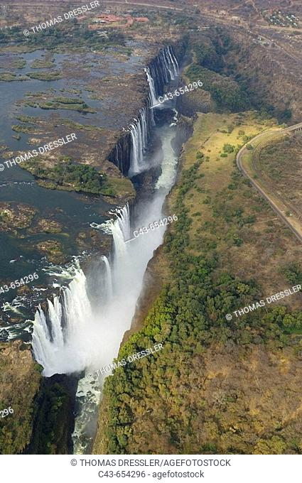 Zimbabwe/Zambia. Aerial view of the Zambezi River and the Victoria Falls (1700m wide). In the foreground the Main Falls (93m high, Zimbabwe)