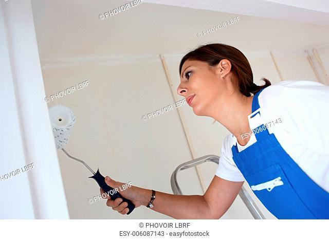 female painter using roller