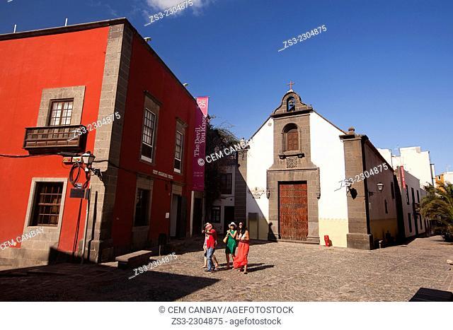 Tourists in front of the Church of Ermita de San Antonio Abad on Plaza San Antonio Abad in historic town centre of Las Palmas de Gran Canaria, Canary Islands