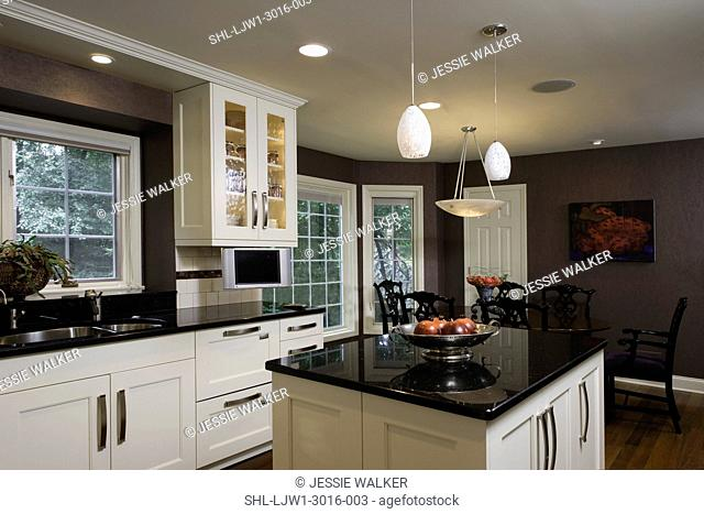 KITCHEN: Contemporary traditional, clean lined dark eggplant colored walls, looking to black Chinese Chippendale style chairs around oval table